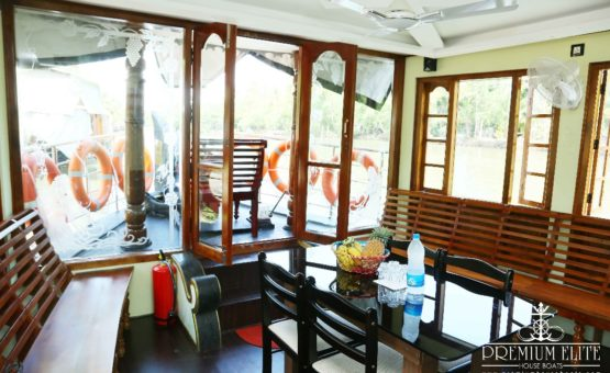 Glass covered area in alleppey houseboat